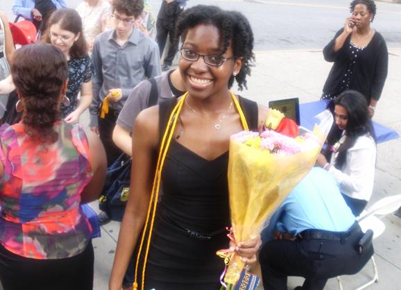 New graduate Emie Lomba, CCNY class of 2012.