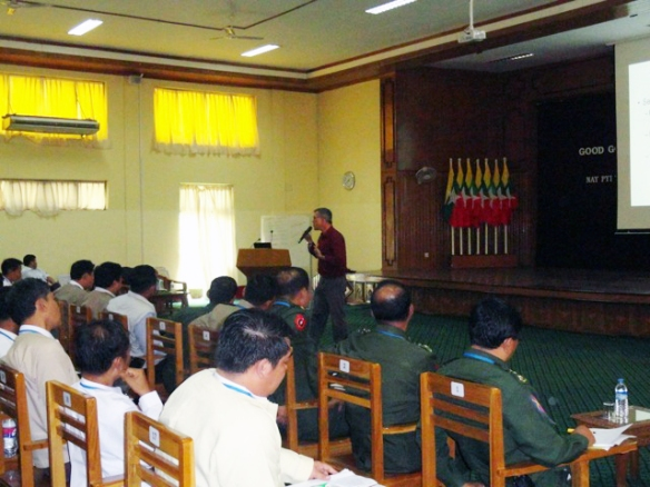 Center Director Vince Boudreau delivers a presentation of governance to Myanmar's military and government personnel.