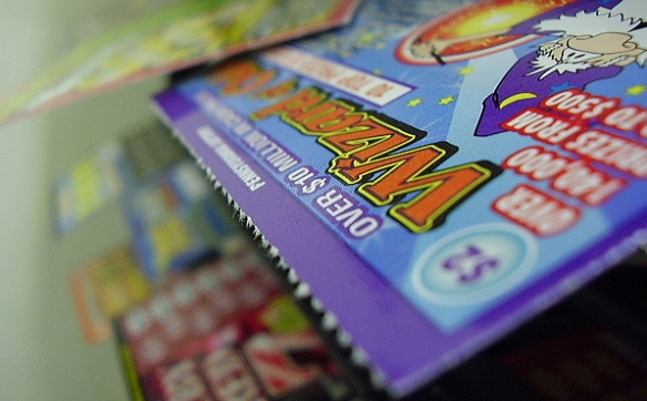 """lottery_tickets. """"This is what I do all day."""" Photo by Lottery Monkey on Flickr, courtesy Creative Commons"""